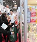 Customers sample a Korean aloe beverage at the Fancy Food Show held in New York in June.