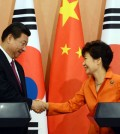 President Park Geun-hye and Chinese President Xi Jinping shake hands during a press conference after a summit at Cheong Wa Dae, Thursday. (Yonhap)