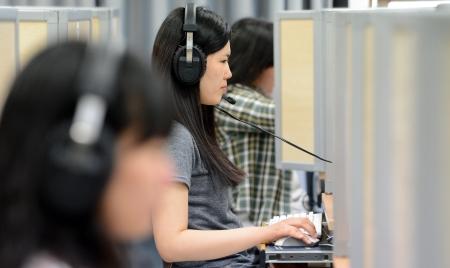 A student takes a high school English exam in Seoul. (Kim Joo-sung / The Korea Times)