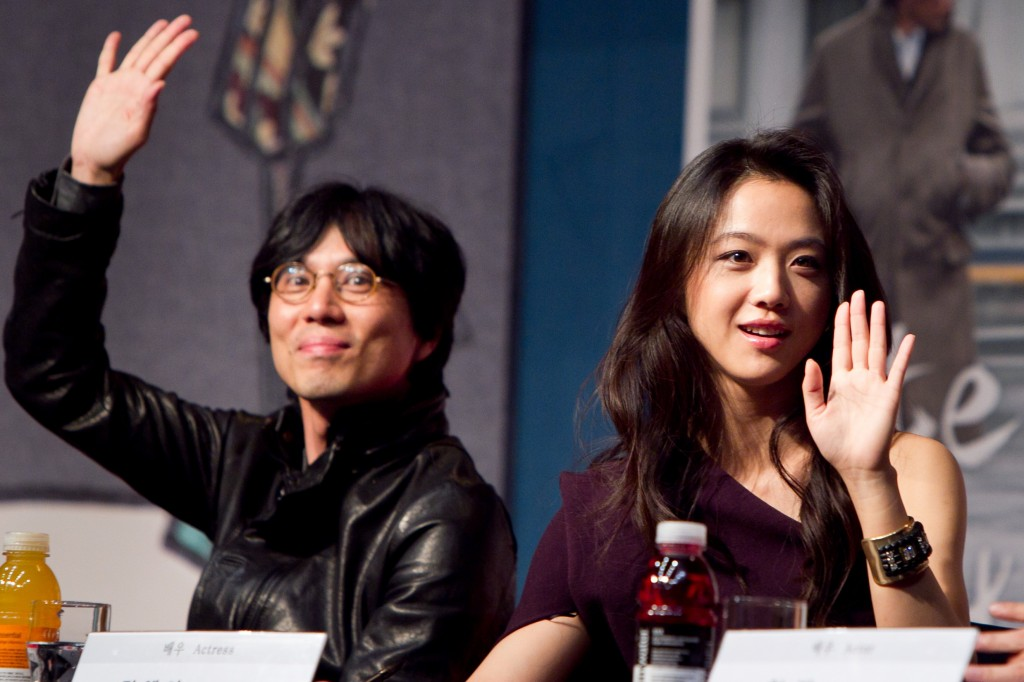 "Tang Wei, right, and Kim Tae-yong during a news conference for Kim's film, ""Late Autumn,"" in Seoul in 2011. (Newsis)"