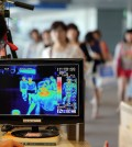 A thermal camera monitor shows the body temperature of passengers arriving from overseas against possible infections of Ebola virus at the Incheon International Airport in Incheon, South Korea, Friday, Aug. 8, 2014. South Korea has been stepping up monitoring of its citizens returning from trips to West Africa and other areas affected by the deadly Ebola virus. (Yonhap)
