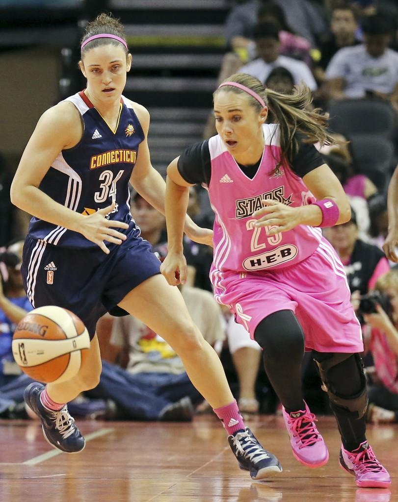 San Antonio Stars' Becky Hammon, right, and Connecticut Sun's Kelly Faris and chase after a loose ball during the first half of a WNBA basketball game, Friday Aug. 1, 2014 at the AT&T Center in San Antonio. (AP Photo/The San Antonio Express-News, Edward A. Ornelas)