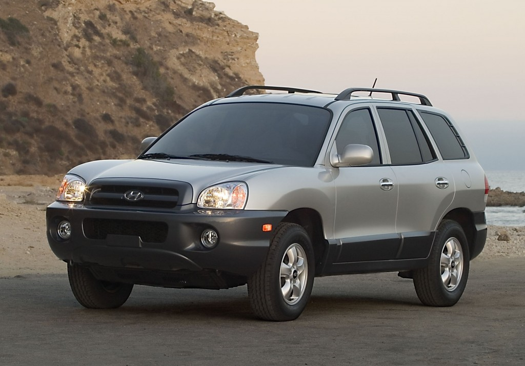 This undated photo provided by Hyundai shows the 2005 Hyundai Santa Fe. Hyundai is recalling more than 419,000 cars and SUVs to fix suspension, brake and oil leak problems. The biggest of three recalls posted Friday, Aug. 1, 2014, by U.S. safety regulators is of 225,000 Santa Fe SUVs from 2001-2006 to replace front coil springs that can rust and crack in cold-weather states. The springs can fracture and make contact with a tire, potentially causing a crash. (AP Photo/Hyundai)
