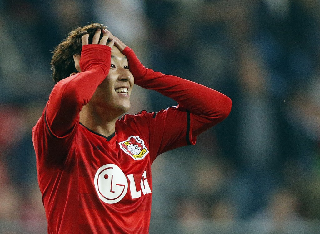Leverkusen's Son Heung-min holds his head  during the Champions League qualifying soccer match between Bayer 04 Leverkusen and FC Copenhagen in Leverkusen, Germany, Wednesday, Aug.27,2014. (AP Photo/Frank Augstein)