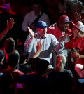 New Los Angeles Clippers owner Steve Ballmer, center, fires up the crowd as he arrives at the Clippers Fan Festival on Monday, Aug. 18, 2014, in Los Angeles. (AP Photo/Jae C. Hong)