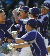South Korea's Hae Chan Choi, center, celebrates with teammates after getting the final out of a 8-4 win in the Little League World Series championship baseball game against Chicago in South Williamsport, Pa., Sunday, Aug. 24, 2014. (AP Photo/Gene J. Puskar)