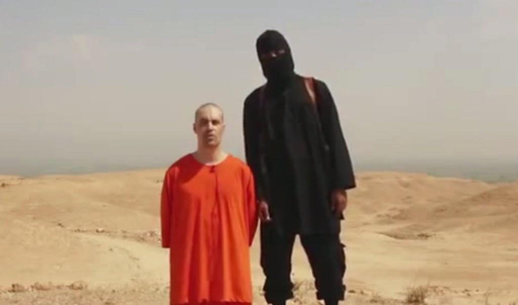 This undated image shows a frame from a video released by Islamic State militants Tuesday, Aug. 19, 2014, that purports to show the killing of journalist James Foley by the militant group. Foley, from Rochester, N.H., went missing in 2012 in northern Syria while on assignment for Agence France-Press and the Boston-based media company GlobalPost. (AP Photo)