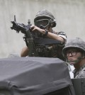 A South Korean aims his machine gun during an anti-terror exercise as part of Ulchi  Freedom Guardian in Seoul, South Korea, Monday, Aug. 18, 2014. The U.S.-South Korean military exercises start Monday and involving tens of thousands of troops are described by the allies as routine and defensive, but Pyongyang sees them as invasion preparation. (AP Photo/Ahn Young-joon)