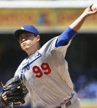 Los Angeles Dodgers starting pitcher Hyun-Jin Ryu works against the San Diego Padres in the first inning of a baseball game Sunday, Aug. 31, 2014, in San Diego.  (AP Photo/Lenny Ignelzi)