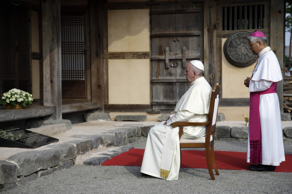 Pope Francis prays with Daejeon Bishop Lazarus You Heung-sik in front of the birthplace of Saint Andrea Kim Dae-gun at the Solmoe Sanctuary, South Korea, Friday, Aug. 15, 2014. (AP Photo/Gregorio Borgia)