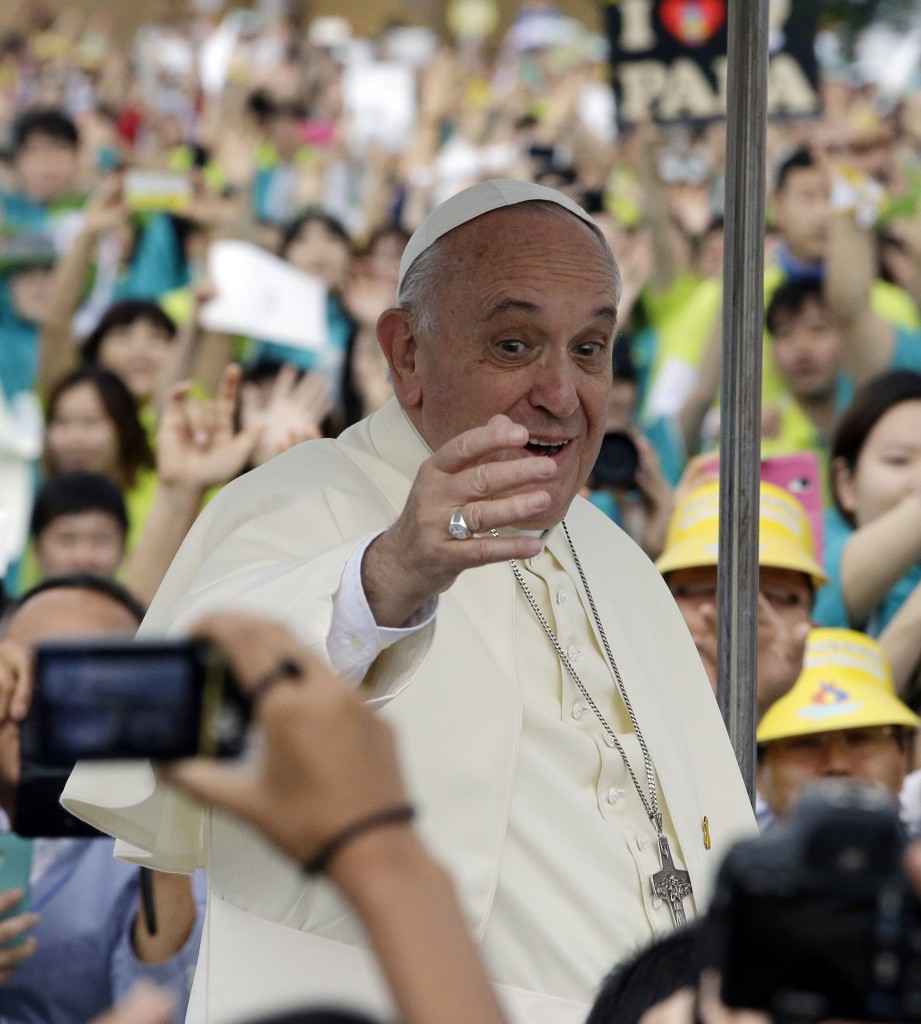 Pope Francis blesses upon arrival for the Closing Holy Mass of the 6th Asian Youth Day at Haemi Castle in Seosan, south of Seoul, South Korea, Sunday, Aug. 17, 2014. (AP Photo/Lee Jin-man, Pool)