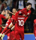 Bayer 04 Leverkusen's Heung-Min Son of South Korea is lifted by teammate Hakan Calhanoglu after Son scored the his teams third goal against FC Copenhagen during the Champions League play-offs first leg soccer match at Parken Stadium, Copenhagen, Denmark, Tuesday, Aug. 19, 2014. (AP Photo/Polfoto, Jens Dresling)