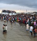 Bangladeshi people gather on the banks of  the River Padma after a passenger ferry capsized in Munshiganj district, Bangladesh, Monday, Aug. 4, 2014. A passenger ferry carrying hundreds of people capsized Monday in central Bangladesh, and at least 44 people either swam to safety or were rescued but the number of missing passengers is not yet known. (AP Photo/ A.M. Ahad)