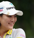 Ryu So-yeon of South Korea, smiles during a delay in action on the third hole during second round play at the Canadian Pacific Women's Open golf tournament in London, Ontario, Friday, Aug. 22, 2014. (AP Photo/The Canadian Press, Dave Chidley)