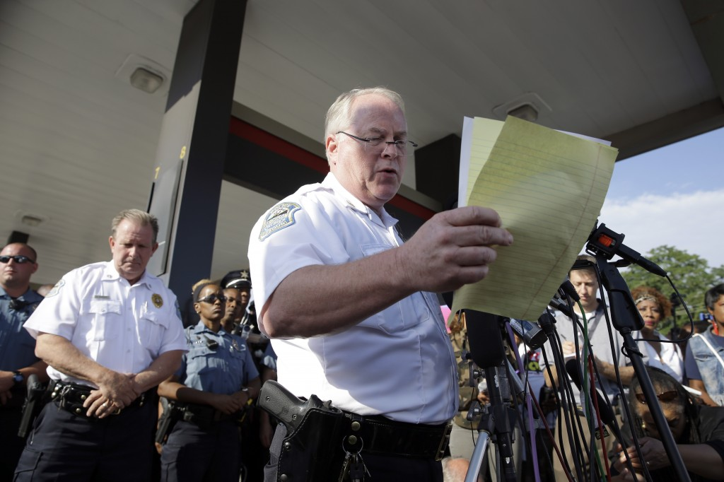 Ferguson Police Chief Thomas Jackson releases the name of the the officer accused of fatally shooting Michael Brown, an unarmed black teenager,  Friday, Aug. 15, 2014, in Ferguson, Mo.  Jackson announced that the officer's name is Darren Wilson. (AP Photo/Jeff Roberson)