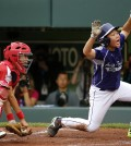Japan catcher Shingo Tomita, left,  misses the tag as South Korea's Jin Woo Jeon scores on a single by Ji Ho Park in the second inning of an International Championship baseball game at the Little League World Series tournament in South Williamsport, Pa., Saturday Aug. 23, 2014. (AP Photo/Gene J. Puskar)