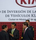 Mexico's President Enrique Pena Nieto, center, talks with KIA Vice Chairman and CEO Hyoung-Keun Lee, left, and the Gov. of Nuevo Leon, Rodrigo Medina, right, during an announcement regarding a new KIA Auto assembly plant to be set up in Mexico, Wednesday, Aug. 27, 2014. KIA announced the construction of a new auto plant in the northern state of Nuevo Leon which is slated to start operating in 2016. (AP Photo/Eduardo Verdugo)