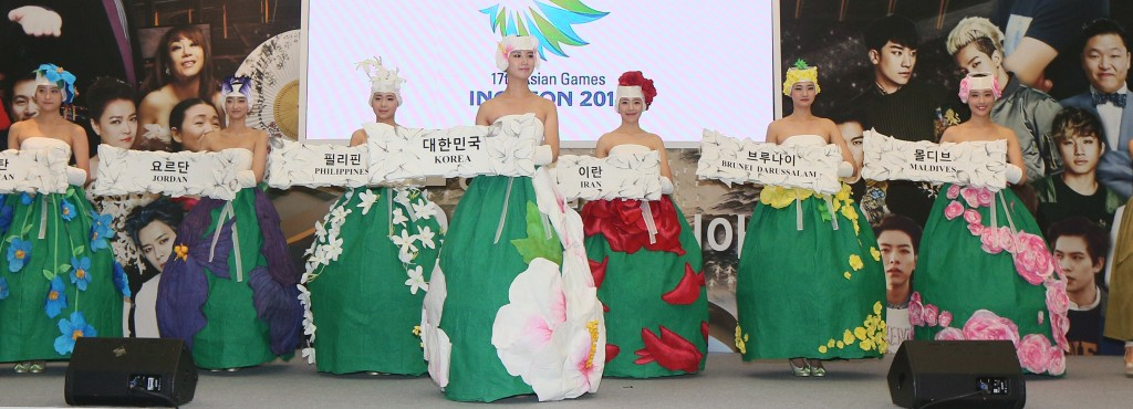 Models pose in modernized traditional clothes, made for the opening ceremony of the 2014 Incheon Asian Games, during a news conference at the National Museum of Modern and Contemporary Art in central Seoul Wednesday. (Yonhap)