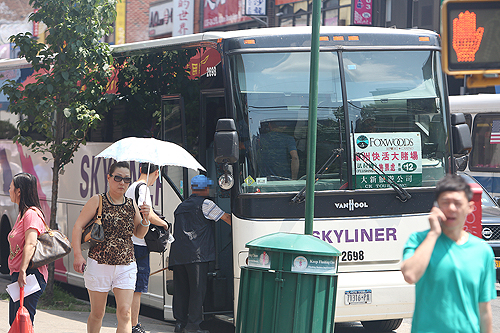 A man steps onto a casino bus on Roosevelt Ave. in Flushing, Queens, on July 31.