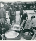 "The caption on the back reads: ""South Korean troops prepare chow on the front lines. Rice Its the main part of the meal. 14 July 1950."" (Official Department of Defense photo)"