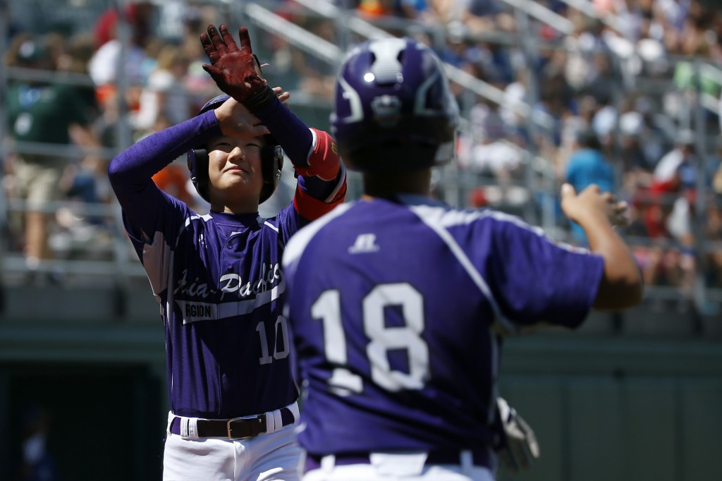 South Korea's Ji Ho Park, left, and Jae Yeong Hwang celebrate after Park's three-run home run during the fourth inning of an international pool play baseball game against the Czech Republic at the Little League World Series, Thursday, Aug. 14, 2014, in South Williamsport. South Korea won 10-3. (AP Photo/Matt Slocum)