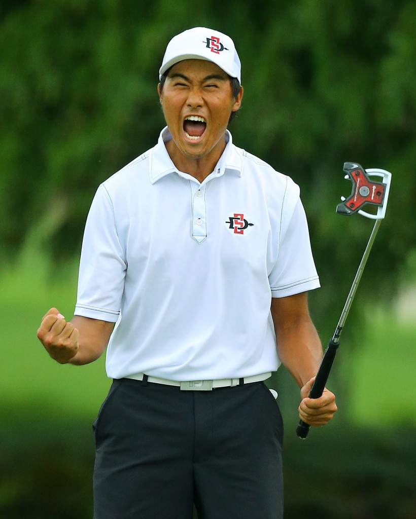 Yang Gunn, of San Diego, Calif., reacts to sinking his par putt on the 17th hole during the afternoon round to win the 36-hole championship match of the 2014 U.S. Amateur Championship at Atlanta Athletic Club on Sunday, Aug.17, 2014, in Johns Creek, Ga.  (AP Photo/Atlanta Journal-Constitution, Curtis Compton)