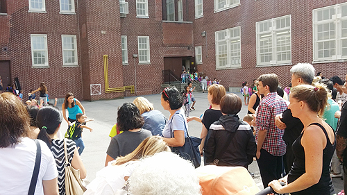 Parents wait for their kindergartners at P.S. 159 in Queens.