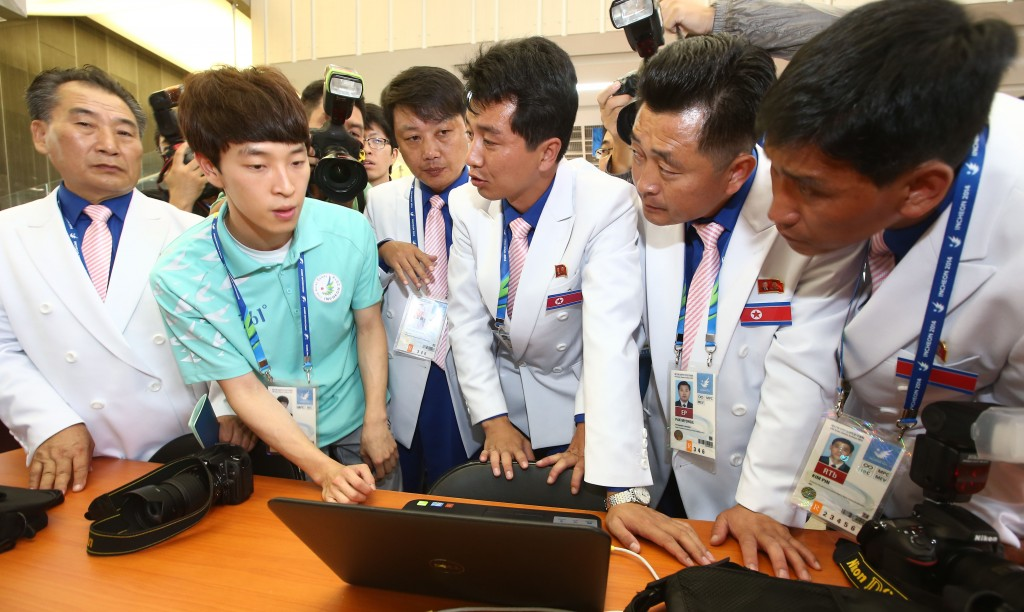 At  the Asian Games press center in Yeonsu-gu, Incheon, North Korean reporters are being informed that they are blocked from accessing a North Korean website. Due to South Korea's National Security Law, the reporters have to send their reports to Pyongyang via fax machine.  (Yonhap)