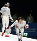 South Korean fencers once again ruled the piste. Kim Ji-yeon shouts in celebration. (Yonhap)