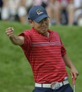 USA's Anthony Kim reacts after winning his match against Europe's Sergio Garcia during the final round of the Ryder Cup golf tournament at the Valhalla Golf Club, in Louisville, Ky., Sunday, Sept. 21, 2008.  (AP Photo/David J. Phillip)