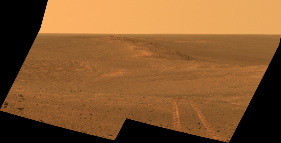 This Aug. 15, 2014, composite image released by NASA and made by NASA's Mars Exploration Rover Opportunity, shows a view looking back toward part of the west rim of Endeavour Crater that the rover drove along, heading southward, during the summer of 2014. (AP Photo/NASA, JPL-Caltech, Cornell University, Arizona State University)