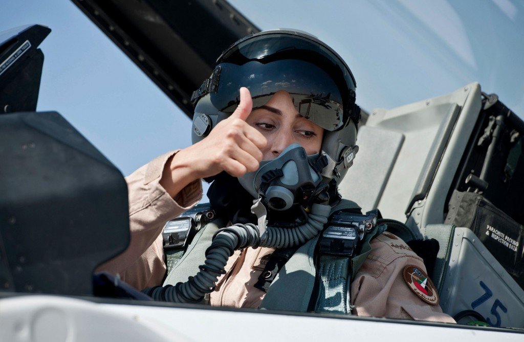This June 13, 2013 photo provided by the Emirates News Agency, WAM, shows Mariam al-Mansouri, the first Emirati female fighter jet pilot gives the thumbs up as she sits in the cockpit of an aircraft, in United Arab Emirates. A senior United Arab Emirates diplomat says the Gulf federation's first female air force pilot helped carry out airstrikes against Islamic State militants earlier this week. The Emirati embassy in Washington said on its official Twitter feed Thursday, Sept. 25, 2014 that Ambassador Yousef al-Otaiba confirmed the F-16 pilot's role. Rumors had swirled on social media that Maj. Mariam al-Mansouri was involved in the strikes, but Emirati officials had not previously confirmed that was the case.(AP Photo/Emirates News Agency, WAM)