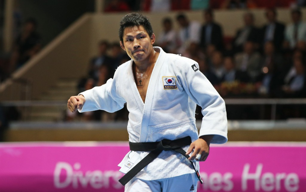 South korea's Kim Jae-bum celebrates his victory over Kazakhstan's Aziz Kalkamanuly during the men's Judo team contest for gold medal at the 17th Asian Games Tuesday, Sept. 23, 2014 in Incheon, South Korea. (AP Photo/Eugene Hoshiko)