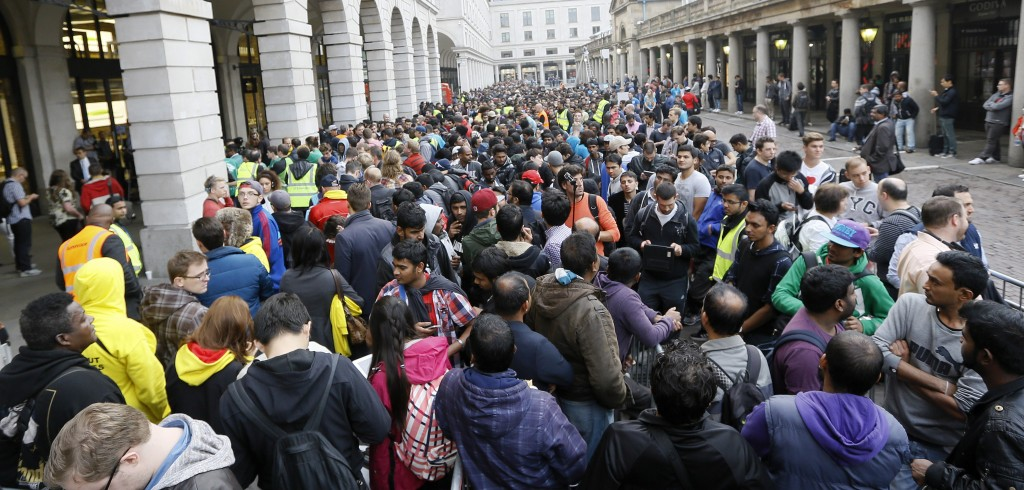 People queue outside the Apple shop in London, Friday, Sept. 19, 2014. The new Apple iPhone6 went on sale at the shop on Friday. (AP Photo/Kirsty Wigglesworth)