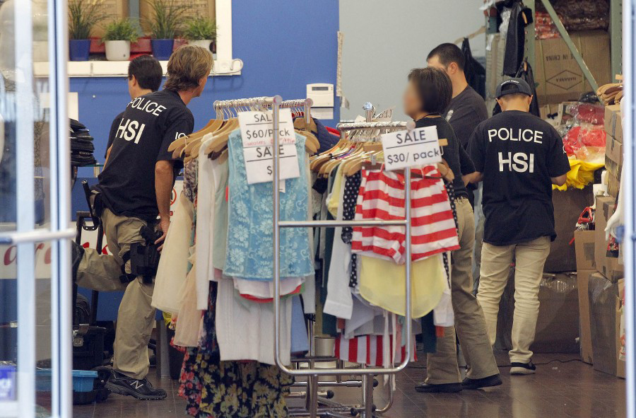Law Enforcement Agents Check A Clothing During Raid In The Los Angeles Fashion District