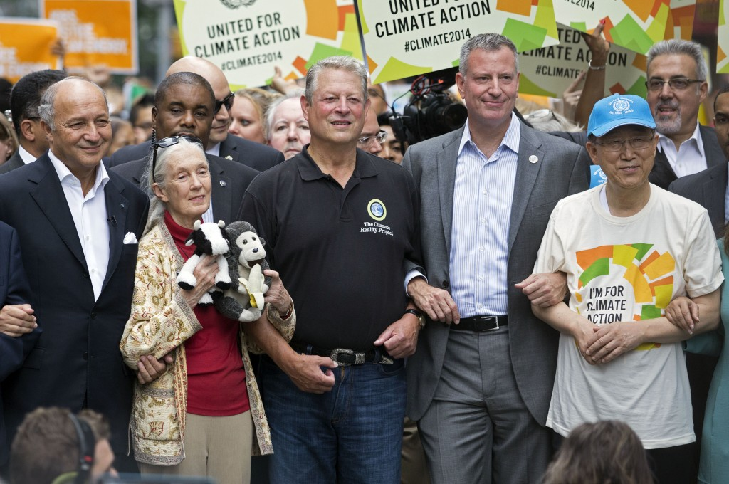 French Foreign Minister Laurent Fabius, from left, primatologist Jane Goodall, former U.S. Vice President Al Gore, New York Mayor Bill de Blasio, and  U.N. Secretary General Ban Ki-moon participate in the People's Climate March in New York, Sunday, Sept. 21, 2014. Thousands of demonstrators filled the streets of Manhattan on Sunday, accompanied by drumbeats, wearing costumes and carrying signs as they urged policy makers to take global action on climate change. (AP Photo/Craig Ruttle)