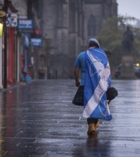 A lone YES campaign supporter walks down a street in Edinburgh after the result of the Scottish independence referendum, Scotland, Friday, Sept. 19, 2014. Scottish voters have rejected independence and decided that Scotland will remain part of the United Kingdom. The result announced early Friday was the one favored by Britain's political leaders, who had campaigned hard in recent weeks to convince Scottish voters to stay. It dashed many Scots' hopes of breaking free and building their own nation. (AP Photo/PA, Stefan Rousseau)
