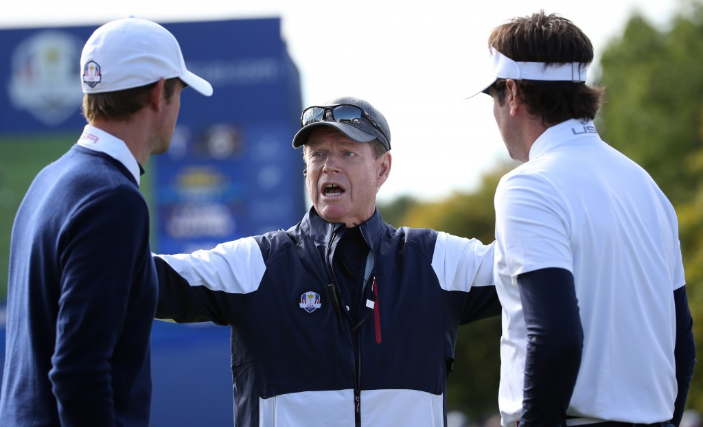 US team captain Tom Watson, center, talks with Webb Simpson, left, and Bubba Watson, right, on the first day of the Ryder Cup golf tournament, at Gleneagles, Scotland, Friday, Sept. 26, 2014. (AP Photo/Scott Heppell)