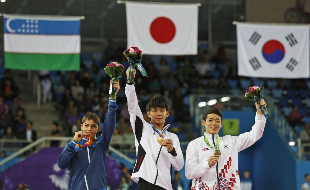 From left to right, silver medallist Uzbekistan's Abdulla Azimov, gold medallist Japan's Masayoshi Yamamoto and bronze medallist South Korea's Park Min-soo celebrate during the medal ceremony for the gymnastics men's pommel horse final at the 17th Asian Games in Incheon, South Korea, Wednesday, Sept. 24, 2014.  (AP Photo/Kin Cheung)
