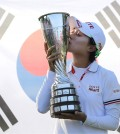 Kim Hyo-joo of South Korea kisses her trophy as she poses for photographers after winning the Evian Championship women's golf tournament in Evian, eastern France, Sunday, Sept. 14, 2014. (AP Photo/Laurent Cipriani)