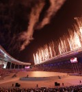 Fireworks explode from the roof of the Asiad Stadium during the opening ceremony for the 17th Asian Games in Incheon, South Korea,Friday, Sept. 19, 2014. (AP Photo/Dita Alangkara)