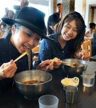 A customer at a Koreatown restaurant enjoys an ice-filled bowl of cold nengmyun. (Park Sang-hyuk/The Korea Times)