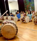 Students participate in a drum class at the KECLA on Aug. 30 for its fall heritage program. (Kim Young-jae/The Korea Times)