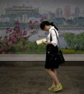 In this Sept. 1, 2014 photo, a North Korean woman waits for a train in an underground subway station in Pyongyang, North Korea.  In Pyongyang, where the standard of living is relatively high, clothes and styles have been changing in recent years - slowly and in a limited way, but more than many outsiders might think. (AP Photo/Wong Maye-E)