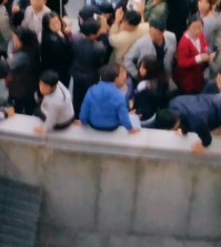 The moment of ventilation grate collapse was captured by one fan's cell phone camera. (Yonhap)