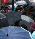 Rain couldn't stop Koreans from getting their iPhones. (Yonhap)