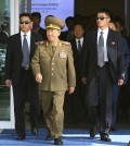 Hwang Pyong So, center left, vice chairman of North Korea's National Defense Commission, and Choe Ryong Hae, center right, a secretaries of the North Korea's ruling Workers Party, arrive at the Incheon International Airport in Incheon, South Korea, Saturday, Oct. 4, 2014. Choe  and other senior officials visited to the South Korea on Saturday for the close of the Asian Games sporting event, South Korean officials said, a rare visit by Pyongyang's inner circle that will include a meeting with Seoul's top official for North Korean affairs.(AP Photo/Yonhap, Kim Do-hoon)
