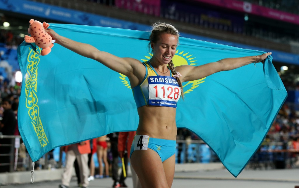 Kazkhstan's Olga Safronova celebrates as she wins the women's 200m final at the 17th Asian Games in Incheon, South Korea,  Wednesday, Oct. 1, 2014.(AP Photo/Rob Griffith)