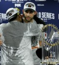 His teammates couldn't thank him enough. San Francisco Giants starting pitcher Madison Bumgarner, right, gets a hug from Pablo Sandoval as Bumgarner won the MVP trophy after their 3-2 win against the Kansas City Royals in Game 7 of baseball's World Series Wednesday, Oct. 29, 2014, in Kansas City, Mo. (AP Photo/Charlie Neibergall)