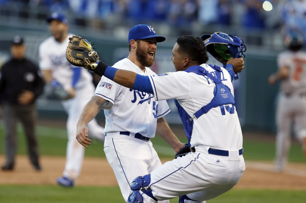 Kansas City Royals relief pitcher Greg Holland and catcher Salvador Perez celebrate after defeating against the Baltimore Orioles 2-1 in Game 4 of the American League baseball championship series Wednesday, Oct. 15, 2014, in Kansas City, Mo. The Royals advance to the World Series. (AP Photo/Orlin Wagner)